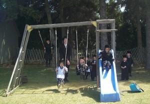 Lev Tahor children play on swings April 24, 2014. Photo Greg Holden